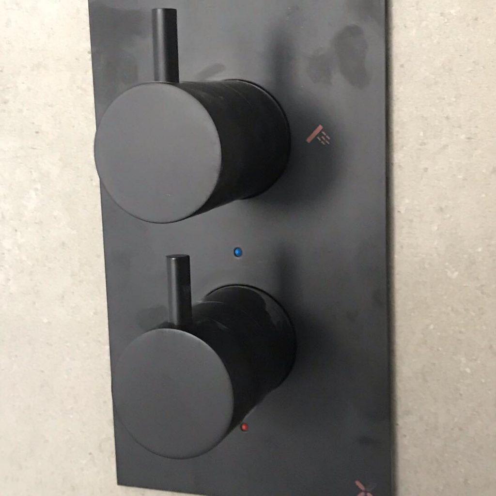 Matt black shower controls